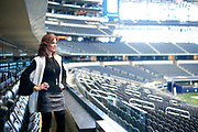 Charlotte Jones Anderson looks out over the field from the owners suite at AT&T Stadium in Arlington, Texas on December 12, 2017. (Cooper Neill for The New York Times)