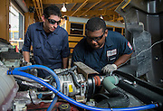David Jane, left, and Derek Thomas, right, inspect an engine at the Northwest bus barn, July 16, 2014.