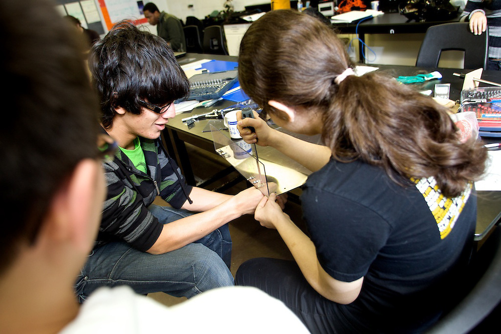 Students at Saint-Henri High School build their entry into the FIRST Robotics competition under the tutelage of Youth Fusion -Fusion Jeunesse interns and engineers from Bombardier.
