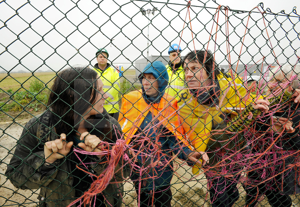 © Licensed to London News Pictures. 08/10/2012. Hinkley Point, Somerset, UK. Picture of protesters behind the perimeter fence, as anti-nuclear campaigners hold a mass trespass protest at the site of Hinkley Point nuclear power station.  Energy company EDF plans to build a new nuclear power plant at the site called Hinkley C.  08 October 2012..Photo credit : Simon Chapman/LNP.