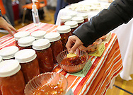 A customer samples fresh salsa during the Indoor Winter Farmers Market at the First Street Community Center at 221 First Street NE in Mount Vernon on Saturday, April 16, 2011.