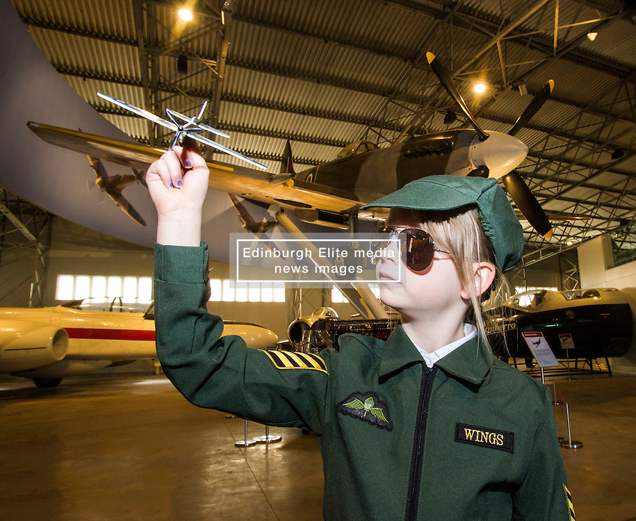 Pictured: Arabella Cotter (7) from  Athelstaneford Primary School, earned her wings: <br /> <br /> The redeveloped National Museum of Flight at East Fortune has undergone a  £3.6 million refurbishment and now has aeroplanes including a Spitfire, a Harrier Jump Jet and a Tornado T-3 on display.    (c) Ger Harley, EEm 22 March 2016