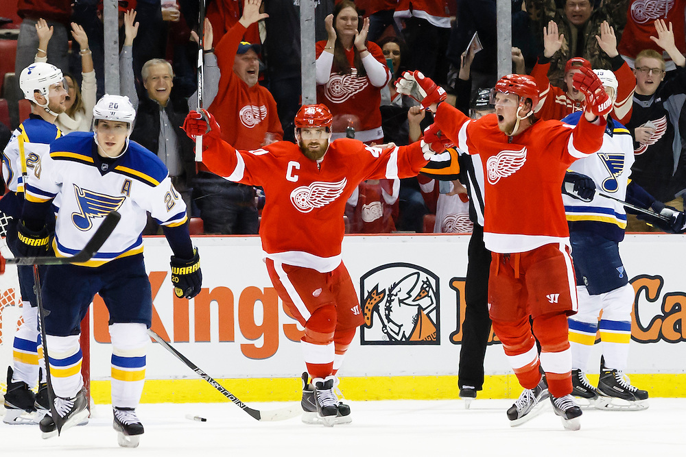 Mar 22, 2015; Detroit, MI, USA; Detroit Red Wings left wing Justin Abdelkader (8) celebrates his goal with left wing Henrik Zetterberg (40) in overtime against the St. Louis Blues at Joe Louis Arena. Detroit won 2-1 in overtime. Mandatory Credit: Rick Osentoski-USA TODAY Sports