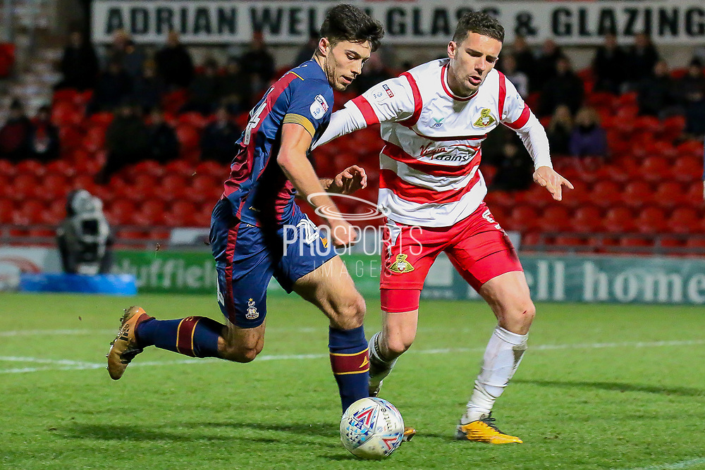 Bradford City midfielder Danny Devine runs at goal as Doncaster Rovers midfielder Jordan Houghton challenges during the EFL Sky Bet League 1 match between Doncaster Rovers and Bradford City at the Keepmoat Stadium, Doncaster, England on 19 March 2018. Picture by Aaron  Lupton.