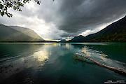 Kenai Lake near Cooper Landing in Alaska, bathed in a golden sun shower.