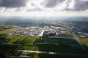 Nederland, Friesland, Gemeente Smallingerland, 28-02-2016; Drachten met Vliegveld Drachten in de voorgrond, gezien naar  knooppunt Drachten (A7/N31). Het vliegveld is ontstaan als airstrip voor de Philipsvestiging.<br /> Drachten with airstrip.<br /> luchtfoto (toeslag op standard tarieven);<br /> aerial photo (additional fee required);<br /> copyright foto/photo Siebe Swart