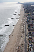 Ocean front jetties and sand restoration along Ocean Ave. Note missing boardwalk and moved sand on Belmar Beach.