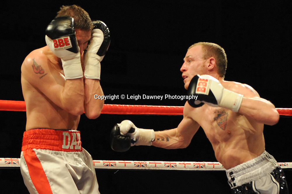 Dale Miles (black shorts) defeats Darren Askew at Coventry Skydome, Coventry, United Kingdom on 23rd April 2010. Frank Maloney Promotions.Photo credit: © Leigh Dawney