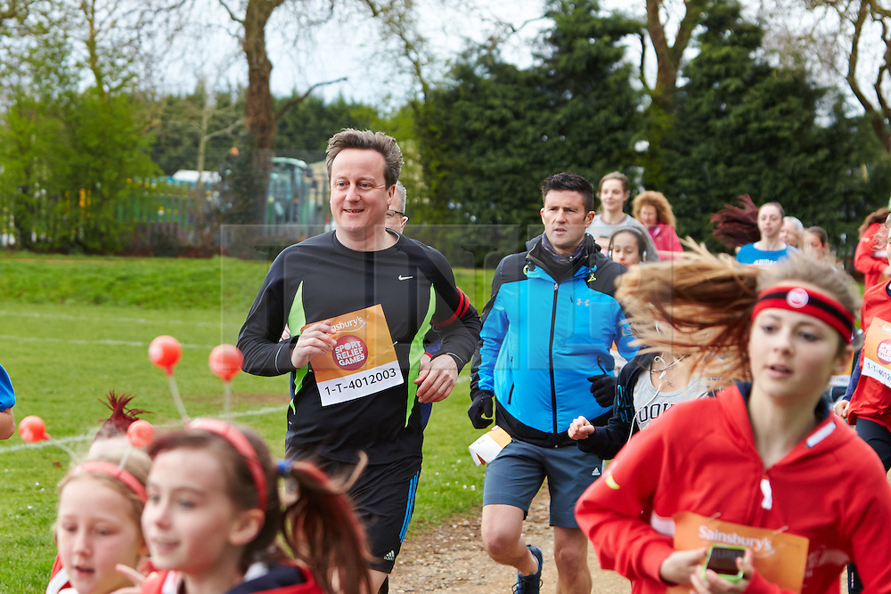 © Licensed to London News Pictures.  23/03/2014. OXFORD, UK. Prime minister DAVID CAMERON (centre left) at the start of the Oxford Sport Relief Mile. Photo credit: Cliff Hide/LNP
