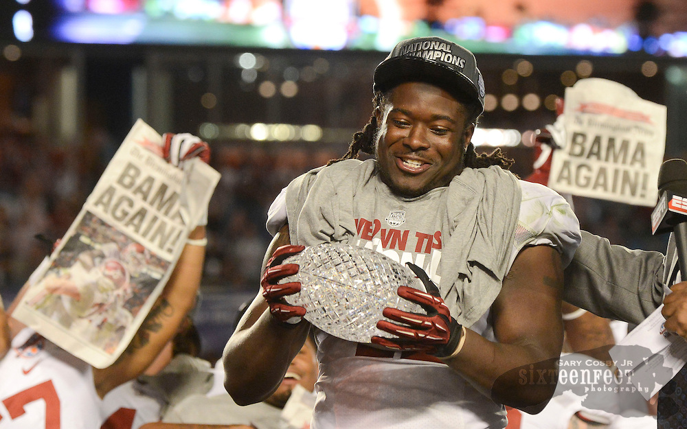 Daily Photo by Gary Cosby Jr.   Alabama celebrates its 25th National Championship after dominating Notre Dame in the BCS Championship Game Monday, January 7, 2013.  Eddie Lacy, offensive MVP, holds the crystal championship football.