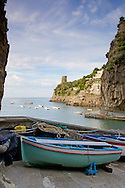 Stretching about 30 miles or 50km along the southern side of the Sorrentine Peninsula, most famous for the town of Sorrento, the Amalfi Coast (Costiera Amalfitana) is one of Europe's most breathtaking. Cliffs terraced with scented lemon groves sheer down into sparkling seas; whitewashed and pastel colored villas cling precariously to unforgiving slopes while sea and sky merge in one vast blue horizon.