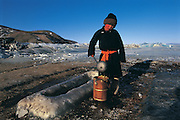 Watering hole in ice<br /> used for animals and people<br /> Lake Hovskol<br /> Mongolia