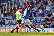 Portsmouth Defender, Christian Burgess (6) blocks Peterborough United Midfielder, Danny Lloyd (10) shot at goal during the EFL Sky Bet League 1 match between Portsmouth and Peterborough United at Fratton Park, Portsmouth, England on 5 May 2018. Picture by Adam Rivers.