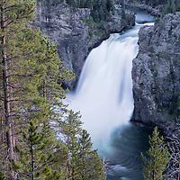 Yellowstone River flowing over the Upper Yellowstone Falls, located in Canyon Section of Yellowstone National Park, Wyoming.