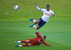 KIRKBY, ENGLAND - Saturday, August 10, 2019: Liverpool's Rhian Brewster sends Tottenham Hotspur's captain TJ Eyoma flying with a challenge during the Under-23 FA Premier League 2 Division 1 match between Liverpool FC and Tottenham Hotspur FC at the Academy. (Pic by David Rawcliffe/Propaganda)