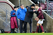 Heart of Midlothian assistant manager Austin McPhee in discussion with Harry Cochrane (#47) of Heart of Midlothian during the William Hill Scottish Cup 4th round match between Heart of Midlothian and Hibernian at Tynecastle Stadium, Gorgie, Scotland on 21 January 2018. Photo by Craig Doyle.