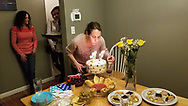 Meaghen Quinn blows out candles at a birthday party in her new home.