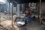 8 April 2010, Ugbekuma, Cross River, Nigeria..Frying grated cassava called garri in Nigeria. Garri is a staple meal in southern Nigeria.