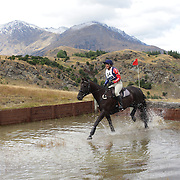 Pamela Thompson riding Dan Carter in action at the water jump during the Cross Country event at the Wakatipu One Day Horse Trials at the Pony Club grounds,  Queenstown, Otago, New Zealand. 15th January 2012. Photo Tim Clayton