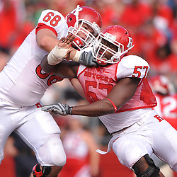Apr 24, 2010; Piscataway, NJ, USA; White offensive lineman Remo Fioranelli (68) blocks Scarlet defensive end Sorie Bayoh (57) during Rutgers Scarlet and White intersquad NCAA football scrimmage at Rutgers Stadium. The Scarlet squad defeated the White, 16-7.