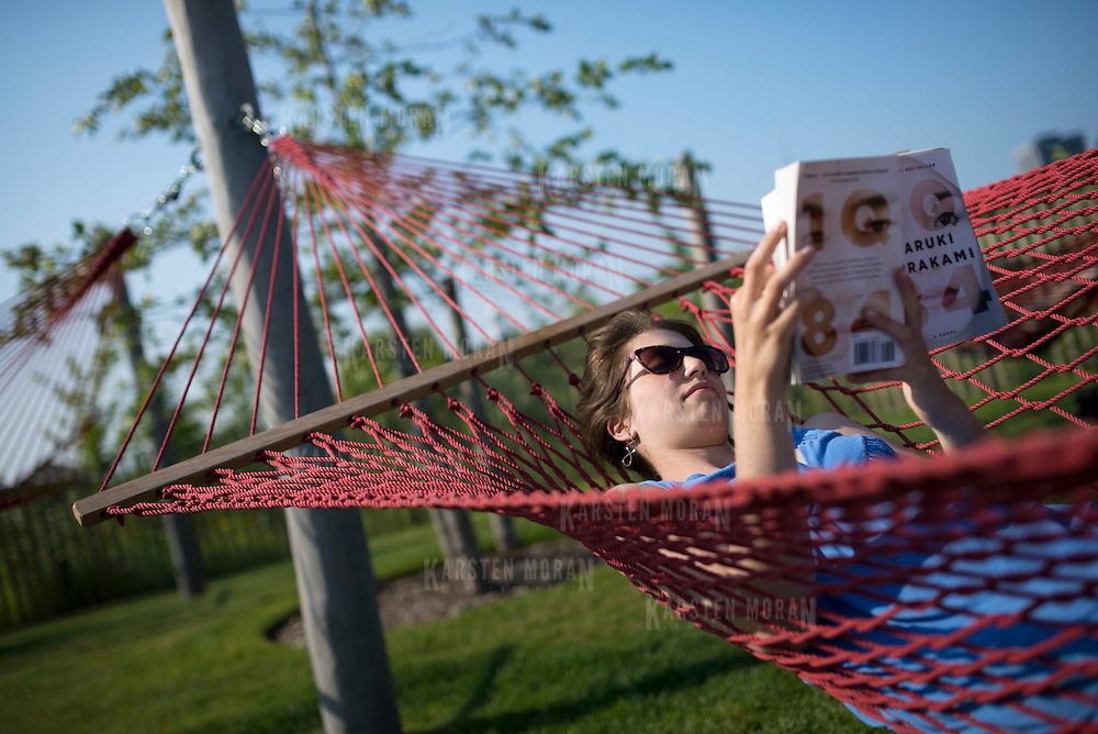 July 12, 2014 - New York, NY : Annie Kravet reads a book as she hangs out in Hammock Grove on Governor's Island on Saturday afternoon.  The 172-acre island, which served for nearly two centuries as a military installation, was taken over by the City and State of New York (152 acres), and the National Park Service (22 acres), in 2003. CREDIT: Karsten Moran for The New York Times