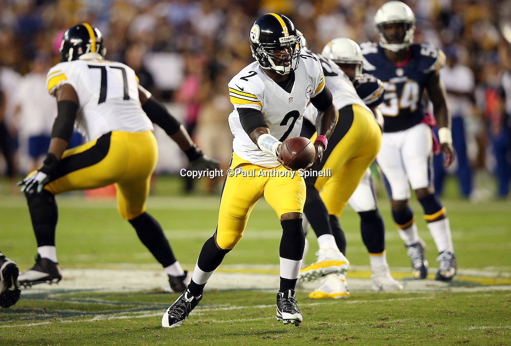 Pittsburgh Steelers quarterback Mike Vick (2) hands off the ball in the second quarter during the 2015 NFL week 5 regular season football game against the San Diego Chargers on Monday, Oct. 12, 2015 in San Diego. The Steelers won the game 24-20. (©Paul Anthony Spinelli)