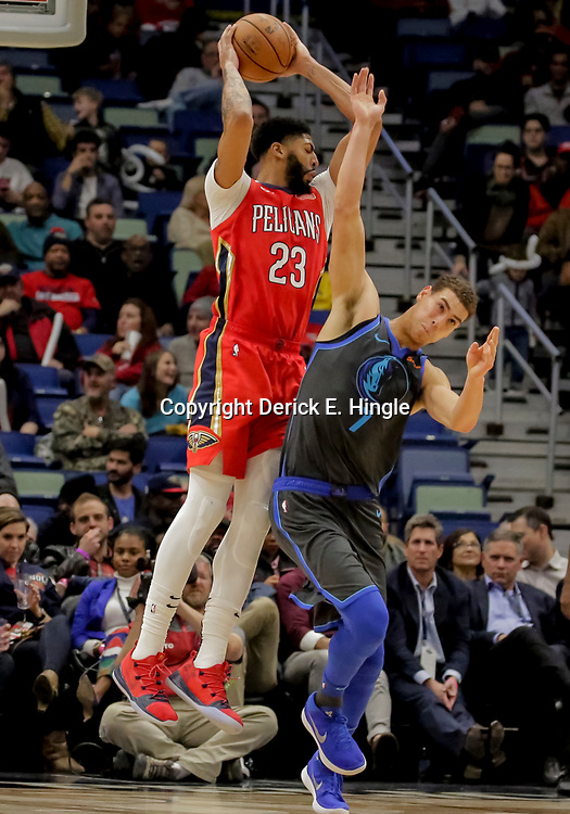 Dec 5, 2018; New Orleans, LA, USA; New Orleans Pelicans forward Anthony Davis (23) rebounds over Dallas Mavericks forward Dwight Powell (7) during the second half at the Smoothie King Center. Mandatory Credit: Derick E. Hingle-USA TODAY Sports