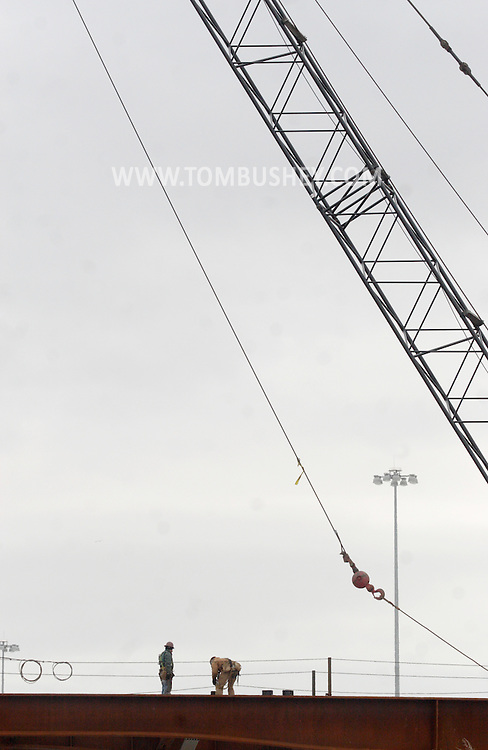 Town of Newburgh, NY - Two workers stand on steel beams as construction continues on the new Interstate 84-Interstate 87 interchange project on Feb. 27, 2008. Currently there is no direct connection between the two highways. The project is expected to be complete in the fall of 2009.