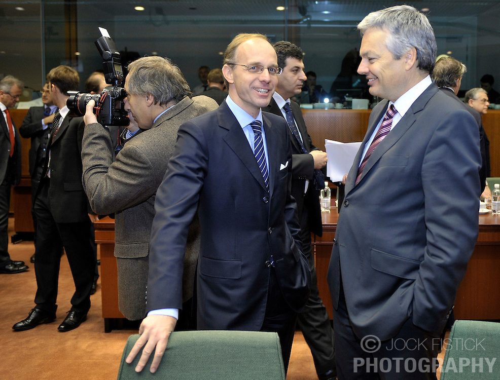 Luc Frieden, Luxembourg's minister of Finance, left, speaks with Didier Reynders, Belgium's finance minister, during ECOFIN, the meeting of EU finance ministers, at the European Council headquarters in Brussels, Belgium, on Tuesday, Nov. 10, 2009. (Photo © Jock Fistick)