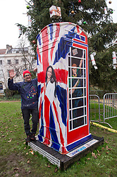 © Licensed to London News Pictures. 05/12/2017. Bristol, UK.  Artist TIMMY MALLETT with his new painting of MEGHAN MARKLE complete with engagement ring and wrapped in the Union Jack on the painted Ring a Royal Phonebox at The Mall Gardens in Clifton Village, Bristol, following the recent announcement of the engagement between Prince Harry and Meghan Markle. Timmy first painted the phone box in 2012 in aid of 25th Childline Anniversary and it has been on public display since 2012 at London's Royal Albert Hall, the O2 Arena and for the last 4 years outside Windsor Castle. The colourful phone box features Her Majesty the Queen, Prince Harry striking the classic Usain Bolt lightning pose, and The Duchess of Cambridge on her mobile with a pram. Photo credit: Simon Chapman/LNP