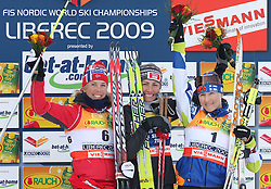 Second placed Kristin Stoermer Steira of Norway, World Champion Justyna Kowalczyk of Poland and third placed Aino Kaisa Saarinen of Finland at Ladies` Pursuit 7,5 km Classic + 7,5 km Free at FIS Nordic World Ski Championships Liberec 2008, on February 21, 2009, in Vestec, Liberec, Czech Republic. (Photo by Vid Ponikvar / Sportida)