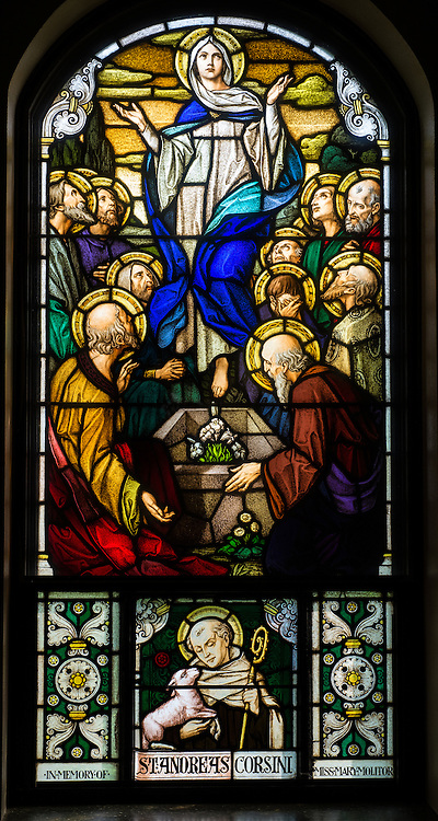 Stained glass image depicts Assumption of the Blessed Virgin Mary. (Sam Lucero photo)
