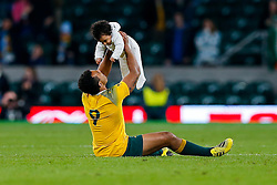 Australia Scrum-Half Will Genia spends a quiet moment in the middle of the pich with his young child after Australia win the match 15-29 - Mandatory byline: Rogan Thomson/JMP - 07966 386802 - 25/10/2015 - RUGBY UNION - Twickenham Stadium - London, England - Argentina v Australia - Rugby World Cup 2015 Semi Finals.