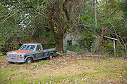 Derelict rundown old Cajun shack and rusty Ford F150 pick-up truck in Louisiana, USA