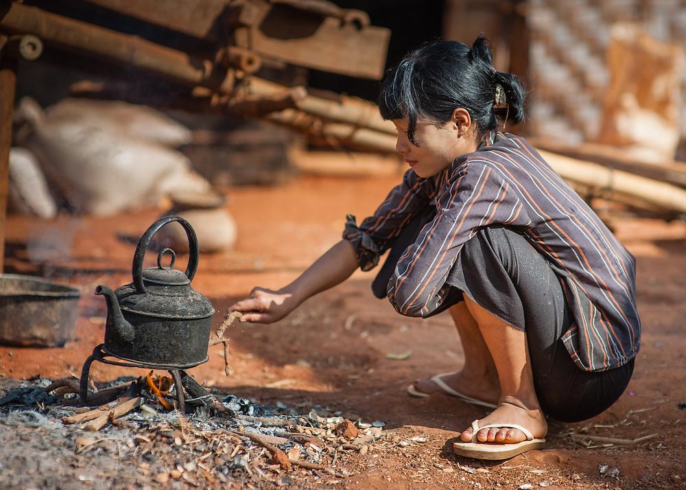 Country young girl making tea (Myanmar)