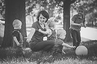 Lisa Johnston | lisa@aeternus.com  | Twitter: @aeternusphoto <br /> <br /> An old Jewish proverb says that &quot;God could not be everywhere, so he created mothers.&quot; It is important to note that motherhood comes in many forms -- from the physical to the spiritual.  Pope Benedict XVI reminds us about Jesus' mother. &ldquo;She who guarded in her heart the secret of divine maternity was the first to see the face of God made man in the tiny fruit of her womb.&rdquo;  <br /> <br /> Eric and Beth Lauver have welcomed three boys into their family. Mom played with Christopher, and triplets, Michael, Alex and Matthew.