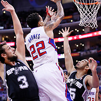 18 February 2014: Los Angeles Clippers small forward Matt Barnes (22) goes for the layup over San Antonio Spurs point guard Cory Joseph (5) past San Antonio Spurs shooting guard Marco Belinelli (3) during the San Antonio Spurs 113-103 victory over the Los Angeles Clippers at the Staples Center, Los Angeles, California, USA.