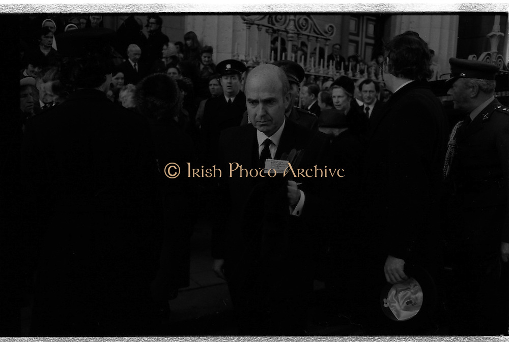 Funeral of Sinead Bean DeValera.    (H82)..1975..09.01.1975..01.09.1975..9th January 1975..Today saw the funeral of Sinead Bean DeValera take place at the Pro Cathedral, Dublin. She was the wife of Ex-President Eamon DeValera. Mrs Devalera was a noted author of childrens literature..Mrs DeValera, Born 3rd June 1878. Died 7th Jan 1975...Image of President O'Dalaigh as he makes his way to his car for the funeral cortege to Glasnevin Cemetery,Dublin.