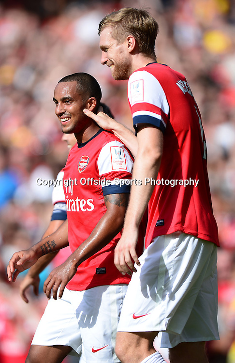 4th August 2013 - Emirates Cup - Arsenal v Galatasary - Theo Walcott of Arsenal celebrates scoring the opening goal with Per Mertesacker - Photo: Marc Atkins / Offside.