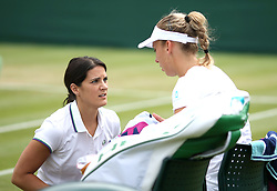 Elise Mertens receives treatment in her round of 16 match against Barbora Strycova on court 12 on day seven of the Wimbledon Championships at the All England Lawn Tennis and Croquet Club, London.