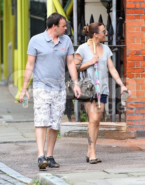 Former Spice Girl Melanie Chisholm aka Mel C out with her younger half-brother Paul O'Neill in north London. The pair stopped of at Starbucks and had a chat on a park bench before heading home. UK. 19/08/2012<br />