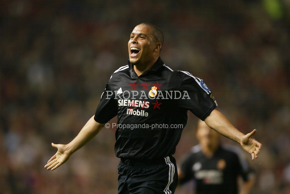MANCHESTER, ENGLAND - Wednesday, April 23, 2003: Real Madrid's Ronaldo celebrates his hat-trick goal Manchester United during the UEFA Champions League Quarter Final 2nd Leg match at Old Trafford. (Pic by David Rawcliffe/Propaganda)