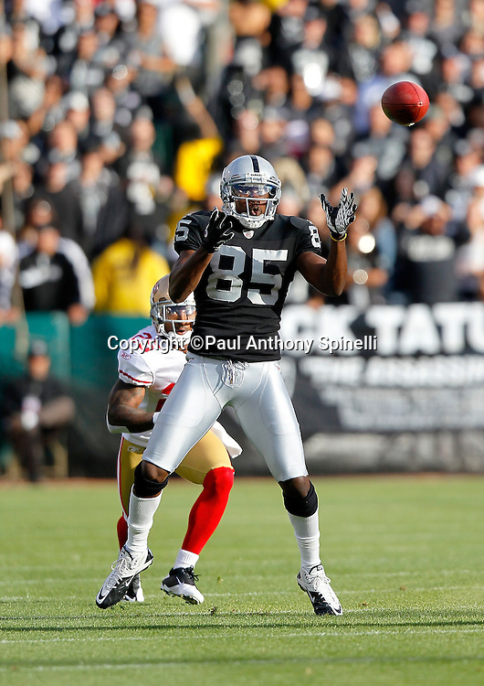 Oakland Raiders wide receiver Darrius Heyward-Bey (85) catches a pass good for a first down on the Raiders first drive during the NFL preseason week 3 football game against the San Francisco 49ers on Saturday, August 28, 2010 in Oakland, California. The 49ers won the game 28-24. (©Paul Anthony Spinelli)