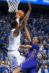 Kentucky forward Skal Labissiere, left, blocks a shot by LSU guard Tim Quarterman in the second half. <br /> <br /> The University of Kentucky hosted the LSU Tigers, Saturday, March 05, 2016 at Rupp Arena in Lexington .