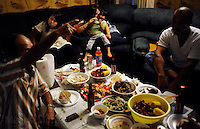 NEW ORLEANS, LA- June 22:  (L-R)  Dung Nguyen talks to family, lisa and Christine Nguyen, 3, and Trung Le, about a cancelled shrimp boat job.... The Nguyens', a Vietnamese fishing family, at home in east New Orleans, New Orleans, Louisiana, Tuesday June 22, 2010.  Dung Nguyen, the father, has been unable to work on the shrimp boat since the spill, and has had to apply for assistance and train for oil spill clean up work. (Melina Mara/The Washington Post)