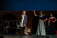 "Kathryn Osburn as Oliver with Chelsea Sasserson at Bet during dress rehearsal for Gilford High School's musical production of ""Oliver"" on Tuesday evening.  (Karen Bobotas/for the Laconia Daily Sun)"
