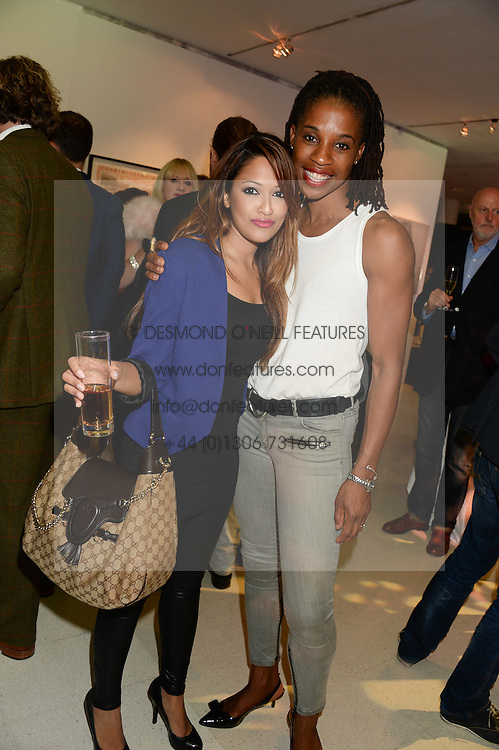 Left to right, TV presenter TASMIN LUCIA-KHAN and athlete JENNY STOUTE at the Macmillan De'Longhi Art Auction 2013 held at the Royal College of Art, London on 23rd September 2013.