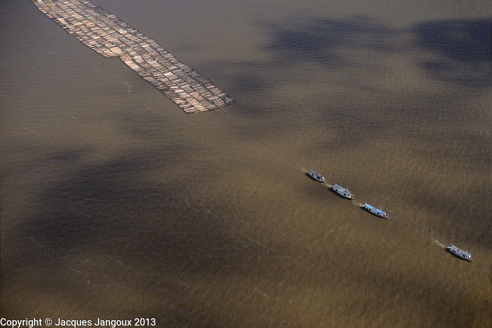Brazil, Amazon region, Para State. Deforestation: raft of logs on lower Amazon river.