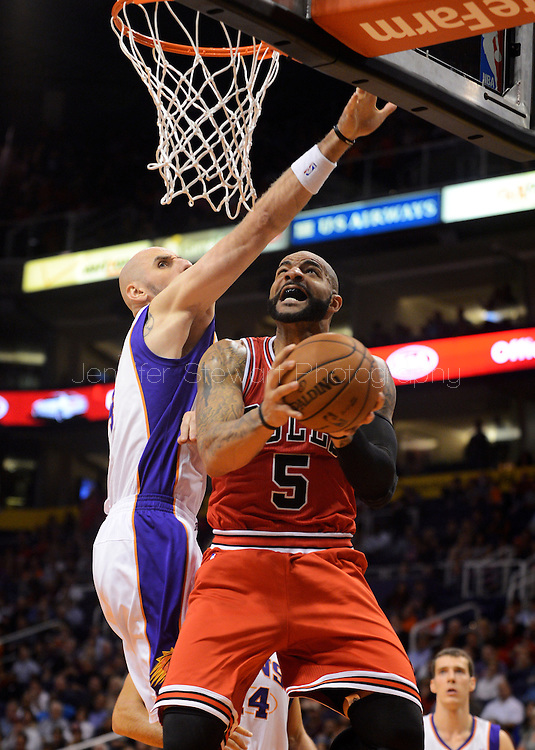 Nov. 14, 2012; Phoenix, AZ, USA; Chicago Bulls forward Carlos Boozer (5) puts up the ball during the game against the Phoenix Suns center Marcin Gortat (4) in the first half at US Airways Center. Mandatory Credit: Jennifer Stewart-US PRESSWIRE