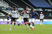 David Raya of Brentford  is challenged by George Evans of Derby County  during the EFL Sky Bet Championship match between Derby County and Brentford at the Pride Park, Derby, England on 11 July 2020.